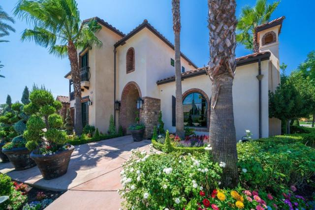 1639 E Clubhouse Drive, Fresno, CA 93730 (#513140) :: FresYes Realty