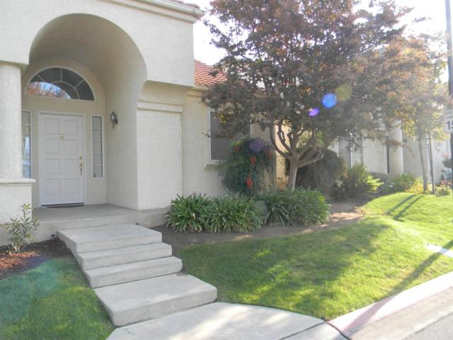 9492 N Whitehouse Drive, Fresno, CA 93720 (#513557) :: Raymer Realty Group