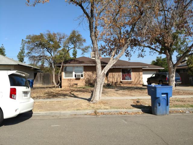 1916 W Buckingham Way, Fresno, CA 93705 (#513601) :: FresYes Realty