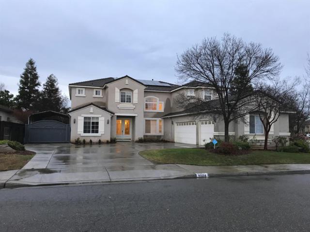 9504 N Larkspur Avenue, Fresno, CA 93720 (#516353) :: FresYes Realty