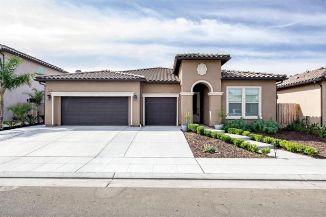 7303 W Wrenwood Lane, Fresno, CA 93723 (#517699) :: Soledad Hernandez Group