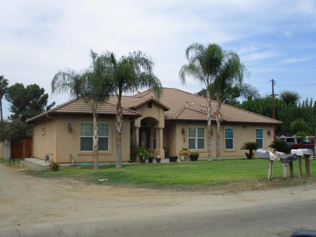336 Riverside Drive, Woodlake, CA 93286 (#520101) :: FresYes Realty