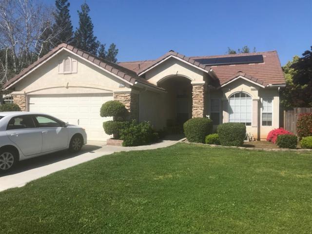 10455 N Woodrow Avenue, Fresno, CA 93730 (#521711) :: Soledad Hernandez Group