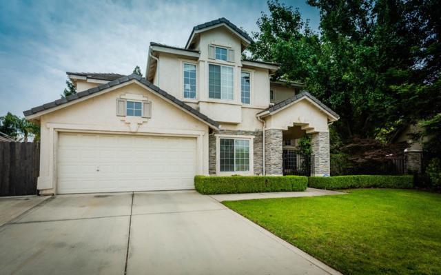2407 E Locust Avenue, Fresno, CA 93720 (#523494) :: FresYes Realty