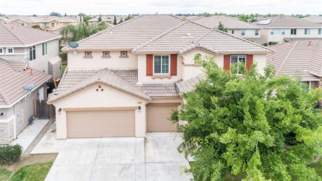 7055 E Garland Avenue, Fresno, CA 93737 (#523703) :: Raymer Realty Group