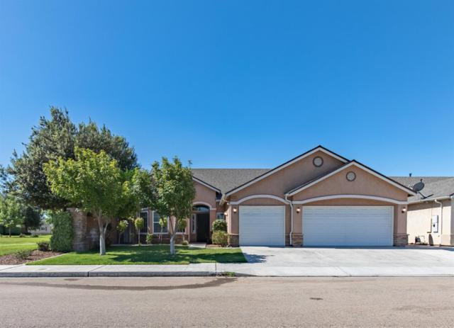 6583 E El Monte Way, Fresno, CA 94727 (#526410) :: Raymer Realty Group