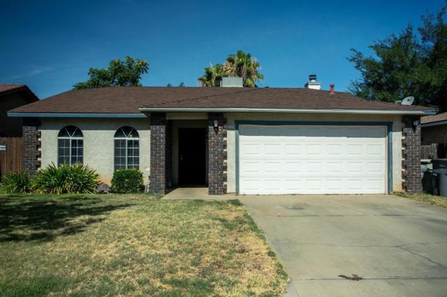 3073 N Dewey Avenue, Fresno, CA 93722 (#527055) :: FresYes Realty