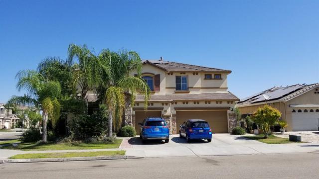 7036 E Robinson Avenue, Fresno, CA 93737 (#527081) :: FresYes Realty