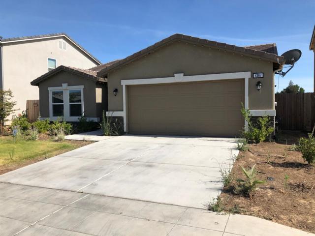 4367 W Saginaw Way, Fresno, CA 93722 (#527088) :: FresYes Realty