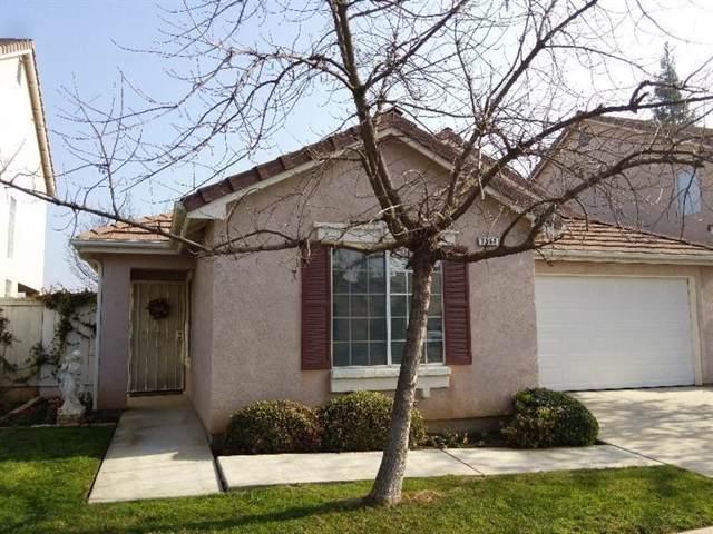 7564 N Trellis Circle, Fresno, CA 93720 (#532400) :: FresYes Realty