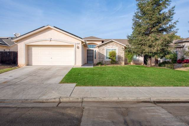 5672 W Carmen Avenue, Fresno, CA 93722 (#533574) :: Dehlan Group