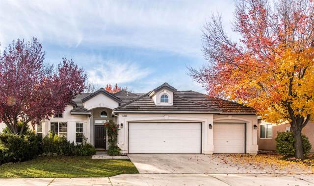 1083 E Olympic Drive, Fresno, CA 93730 (#534769) :: FresYes Realty