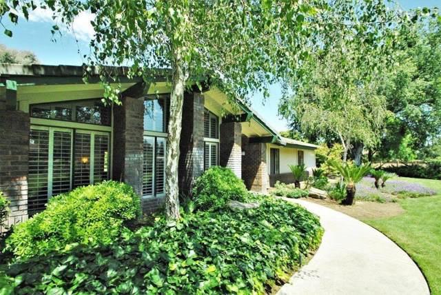 4893 N Tisha Avenue, Fresno, CA 93723 (#535302) :: Twiss Realty