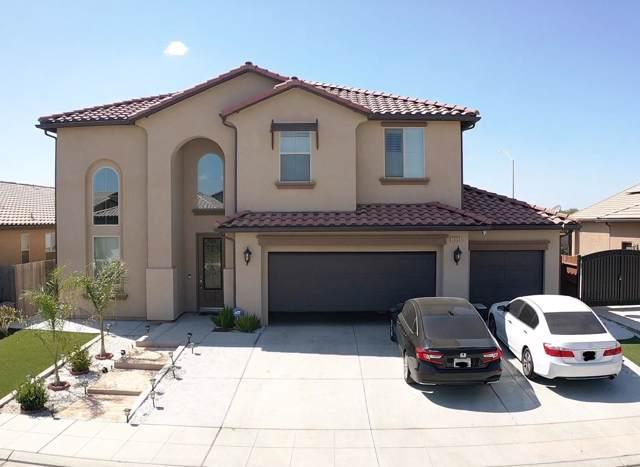 5555 N Lucy Ruiz Avenue, Fresno, CA 93723 (#535326) :: Twiss Realty