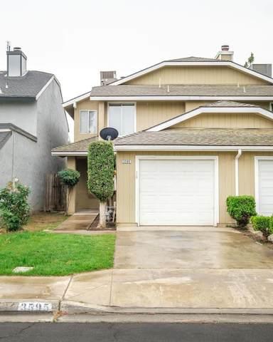 3595 W Harvard Avenue, Fresno, CA 93722 (#539976) :: FresYes Realty