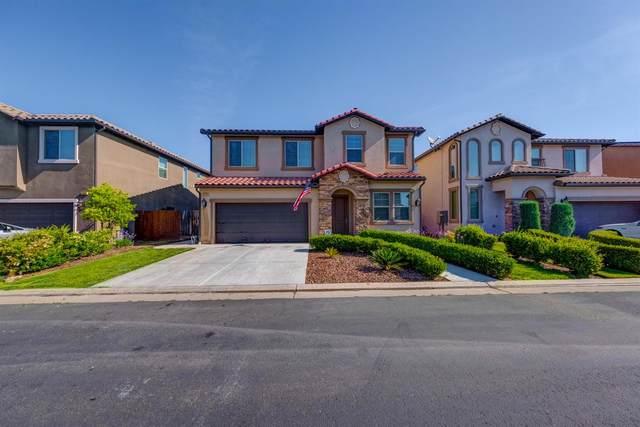 5973 E Via Firenza Drive, Fresno, CA 93727 (#541542) :: Raymer Realty Group