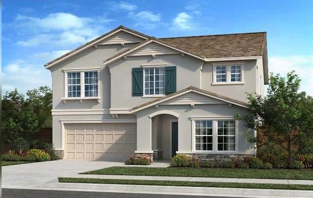 7047 E Peralta Way, Fresno, CA 93727 (#542171) :: FresYes Realty