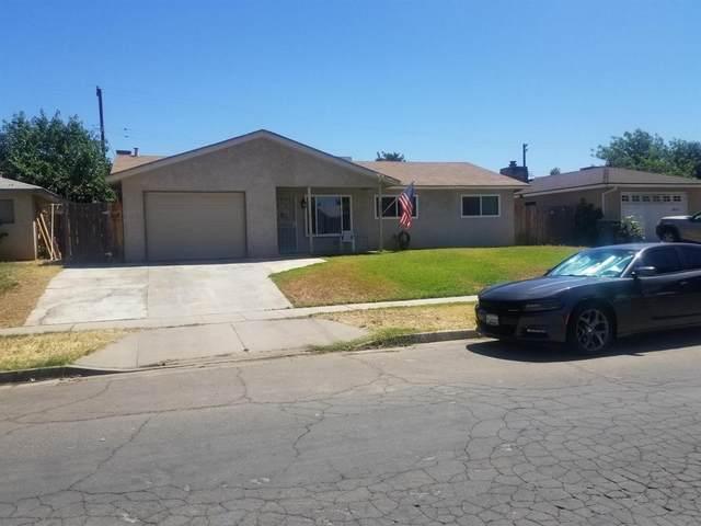 3057 W Hampton Way, Fresno, CA 93722 (#544486) :: FresYes Realty