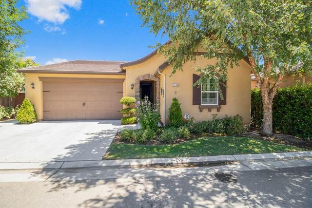 7136 N Inspiration Drive, Fresno, CA 93711 (#545863) :: Dehlan Group