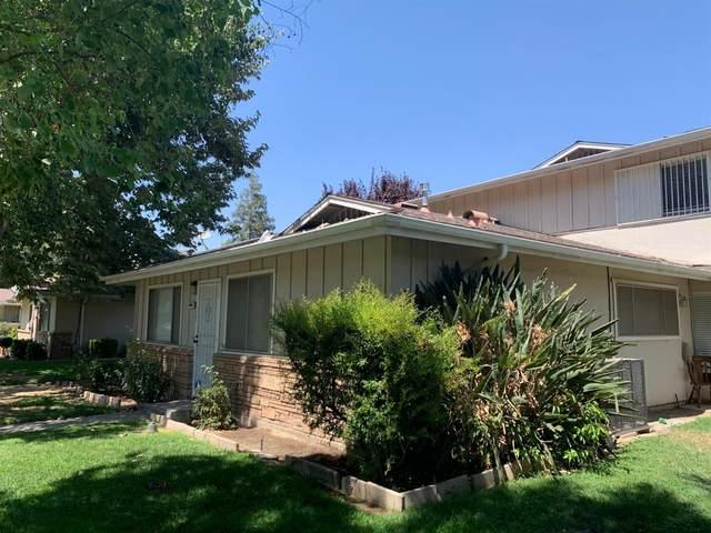 4942 N Holt Avenue #102, Fresno, CA 93705 (#546236) :: FresYes Realty