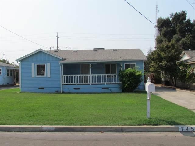 745 W Palm Avenue, Reedley, CA 93654 (#547594) :: FresYes Realty