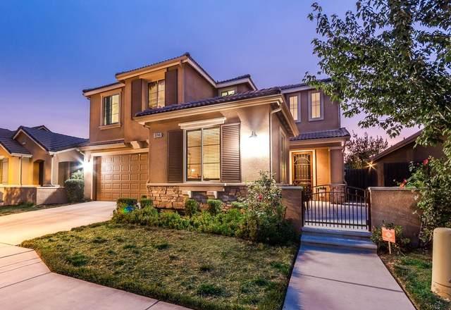3246 Carmelita Avenue, Fresno, CA 93619 (#549764) :: Raymer Realty Group