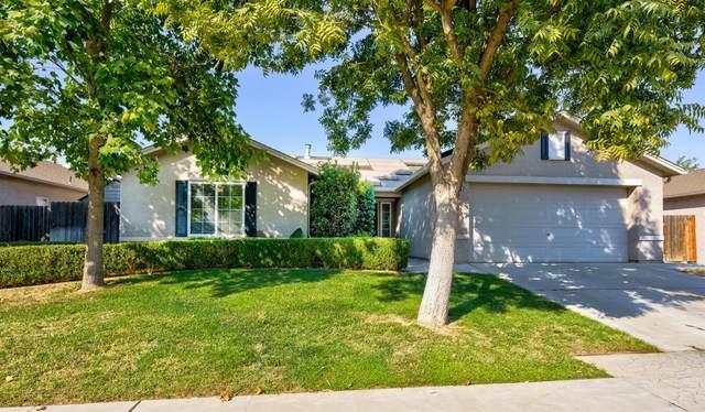 5638 W Carmen Avenue, Fresno, CA 93722 (#550044) :: FresYes Realty