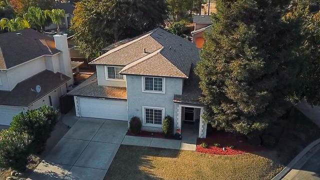 10709 N Seal Cove, Fresno, CA 93730 (#551412) :: Raymer Realty Group
