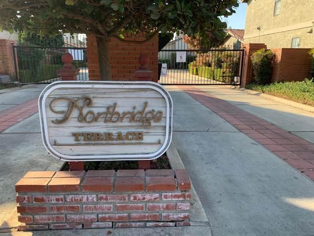 7023 N Teilman Avenue #102, Fresno, CA 93711 (#551530) :: FresYes Realty