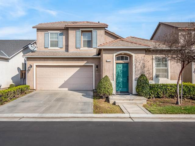 4116 W Peach Tree Lane, Fresno, CA 93722 (#553374) :: Raymer Realty Group