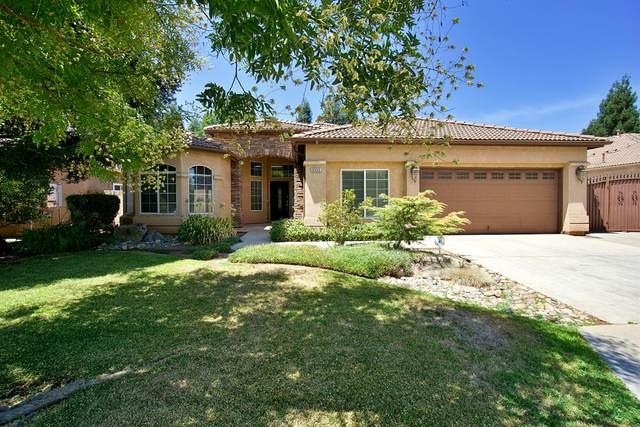 9345 N Jade Avenue, Fresno, CA 93720 (#563480) :: Twiss Realty