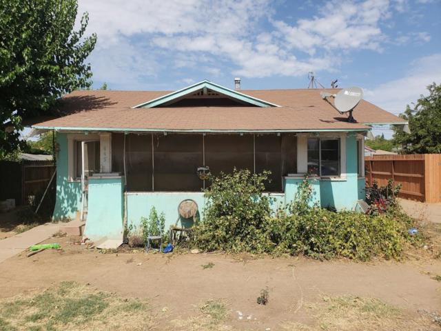 445 5th Street, Orange Cove, CA 93646 (#495160) :: FresYes Realty