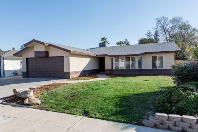 5335 W Hampton Way, Fresno, CA 93722 (#497499) :: FresYes Realty
