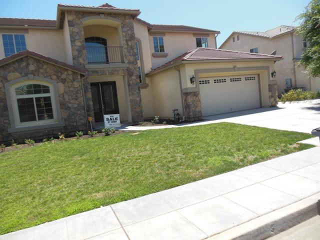 6641 W Celeste Avenue, Fresno, CA 93723 (#505817) :: FresYes Realty