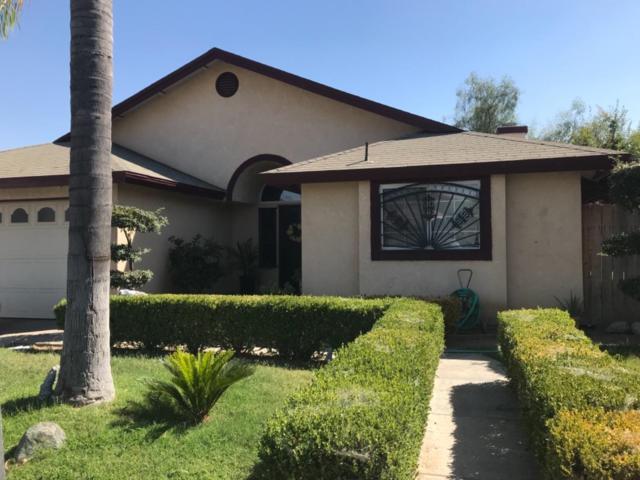 12411 Barton Avenue, Orosi, CA 93647 (#509900) :: Soledad Hernandez Group