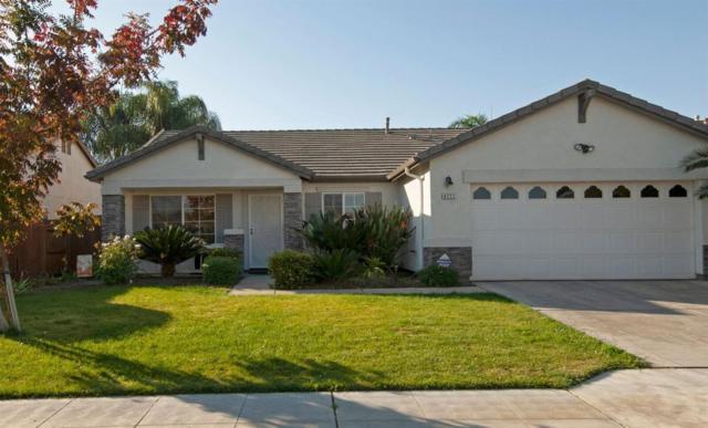 4111 W Weldon Avenue, Fresno, CA 93722 (#512101) :: FresYes Realty