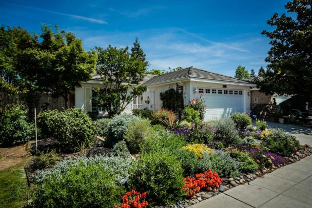 7418 N Mansionette Drive, Fresno, CA 93720 (#521803) :: FresYes Realty