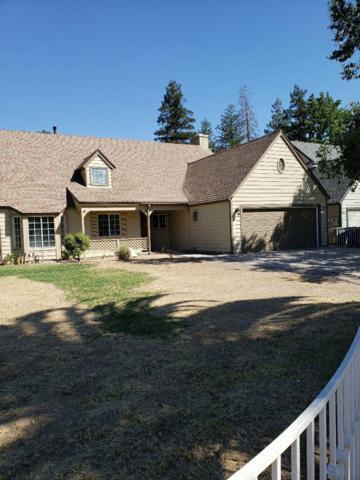 5552 N Gates Avenue, Fresno, CA 93722 (#527076) :: FresYes Realty