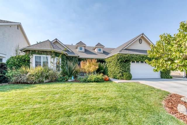 6721 N Lola Avenue, Fresno, CA 93722 (#549790) :: Raymer Realty Group