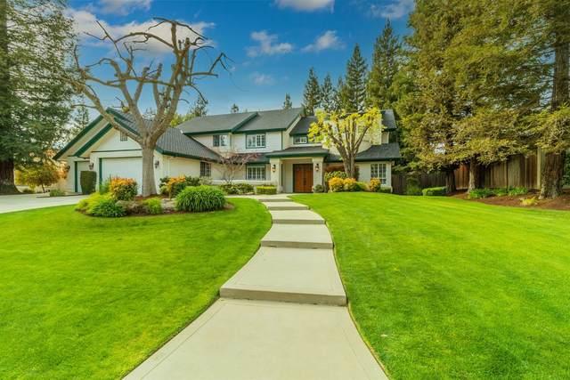 9745 N Madison Ridge Road, Fresno, CA 93720 (#556228) :: Raymer Realty Group