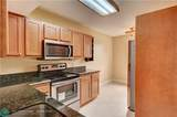 8701 Wiles Rd - Photo 2