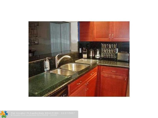 201 Lake Pointe Dr #102, Oakland Park, FL 33309 (MLS #F10094591) :: Castelli Real Estate Services