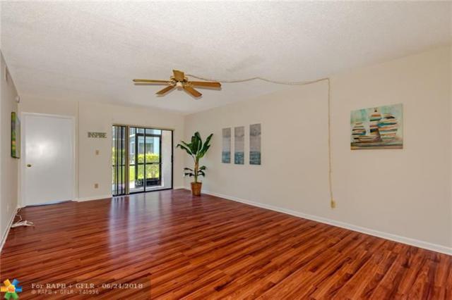 7406 Woodmont Ave #104, Tamarac, FL 33321 (MLS #F10128954) :: Green Realty Properties