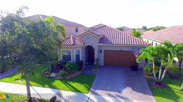 7564 NW 113th Ave, Parkland, FL 33076 (MLS #F10132375) :: The O'Flaherty Team