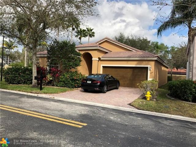1077 NW 116th Ave, Coral Springs, FL 33071 (MLS #F10163105) :: Laurie Finkelstein Reader Team
