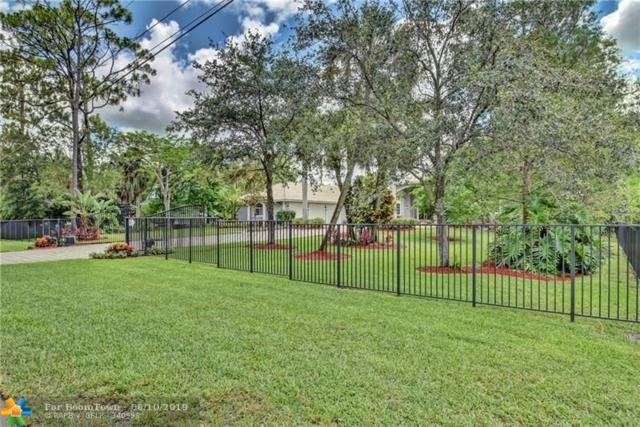 6186 NW 63rd Way, Parkland, FL 33067 (MLS #F10180004) :: Green Realty Properties