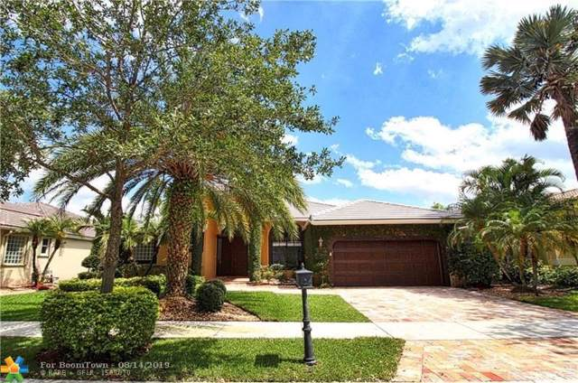 2674 Oakbrook Dr, Weston, FL 33332 (MLS #F10189444) :: Berkshire Hathaway HomeServices EWM Realty
