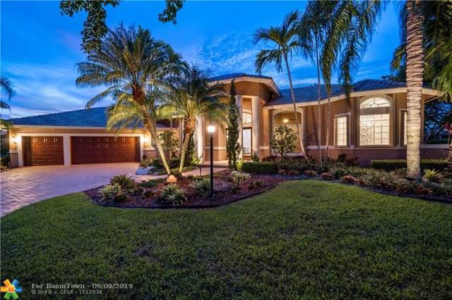 9671 NW 67th Pl, Parkland, FL 33076 (MLS #F10189627) :: Castelli Real Estate Services