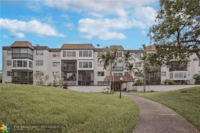 7100 NW 17th St #402, Plantation, FL 33313 (MLS #F10190255) :: Green Realty Properties