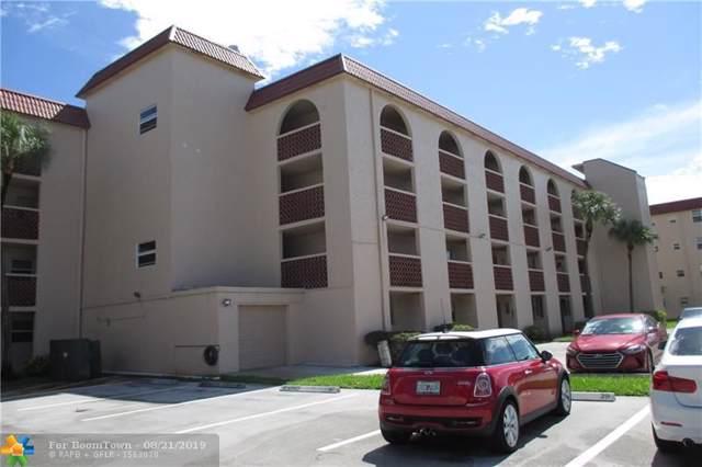 3261 Holiday Springs Blvd #306, Margate, FL 33063 (MLS #F10190584) :: Berkshire Hathaway HomeServices EWM Realty